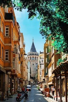 The galata tower in a distance in the karakoy quarter of istanbul in turkey.