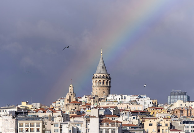 Galata tower or galata kulesi  in istanbul after rain with rainbow on sky, turkey