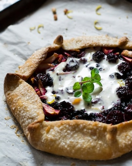 Galette with berries, raspberry, blueberry, blackberry, apple. pie with ice cream, sorbet.