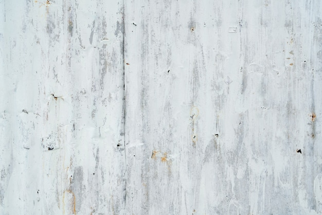 Galvanized sheet painted with white color. empty white wall texture background. peeling paint on white wall.