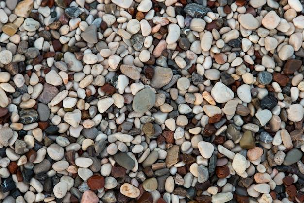 해변의 갈리아카, 작은 색깔의 자갈, 배경, 복사 공간.