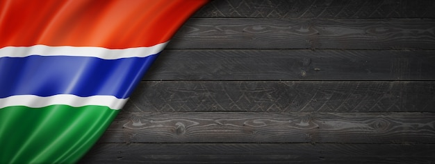Gambia flag on black wood wall