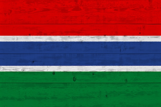 Gambia flag painted on old wood plank