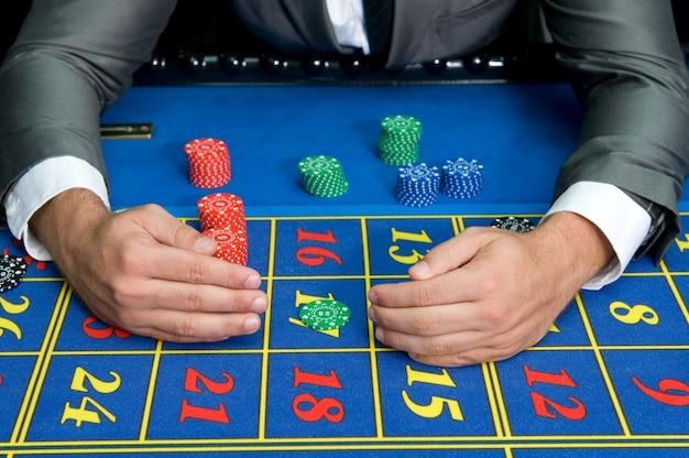 Gambler man at the casino tables