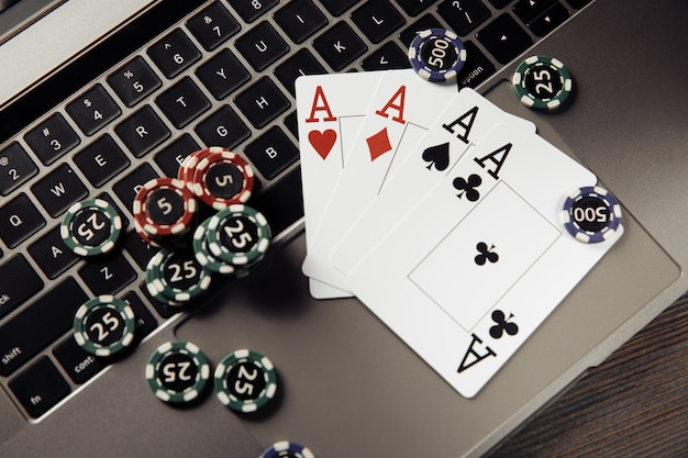 Gambling chips and playing cards on keyboard