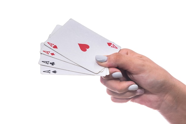 Gambling concept. female hand holding combination of four aces isolated on white