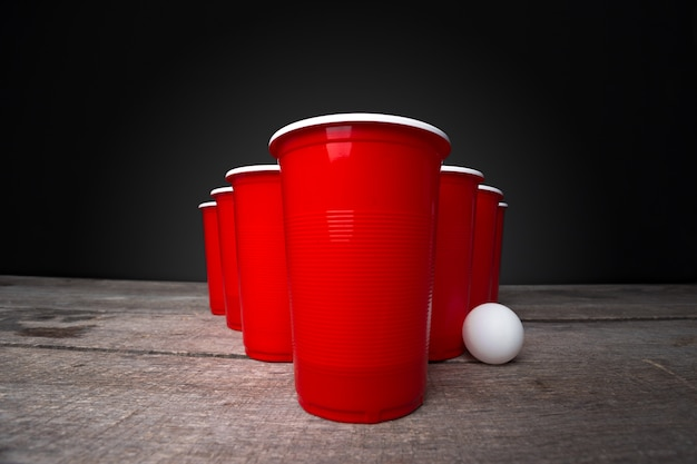 Game beer pong on wooden table