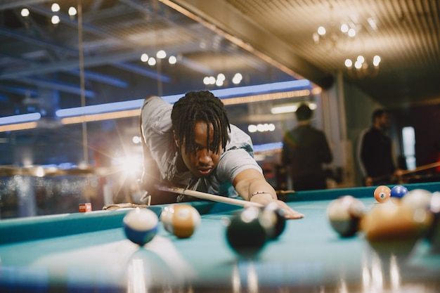 Game of billiards. man with a cane. men's games