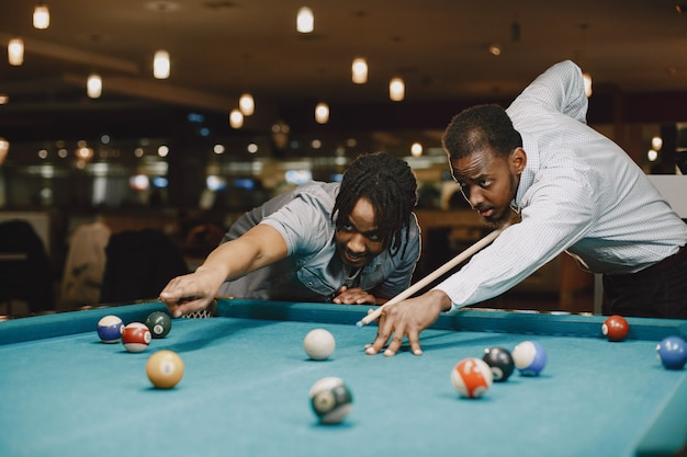 Game of billiards. men with a cane. men's games