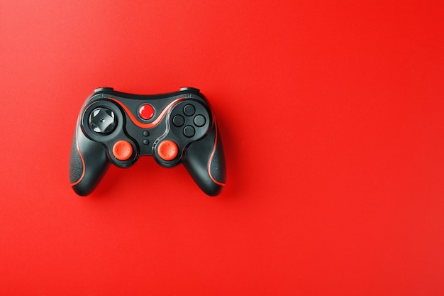 Game controller controller on red surface