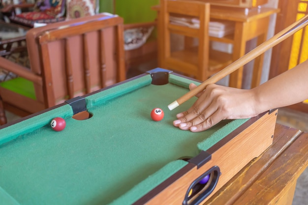Game snooker ready for the ball shot on the green table in bar