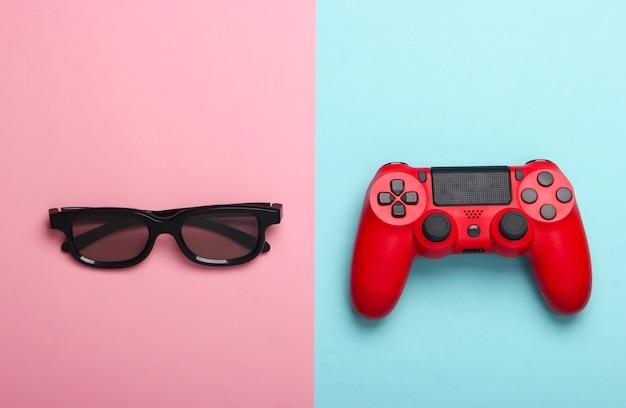 ゲームパッド、ピンクブルーパステルの3dメガネ。