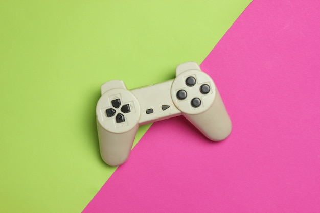 Gamepad on a color background. top view, minimalism.