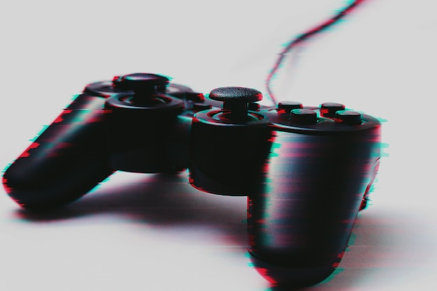 Gamepad in glitch effect on a white background, concept of the game, activity, technology, internet