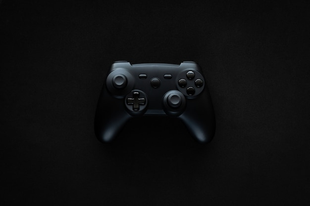 Gamepad on a textured black table