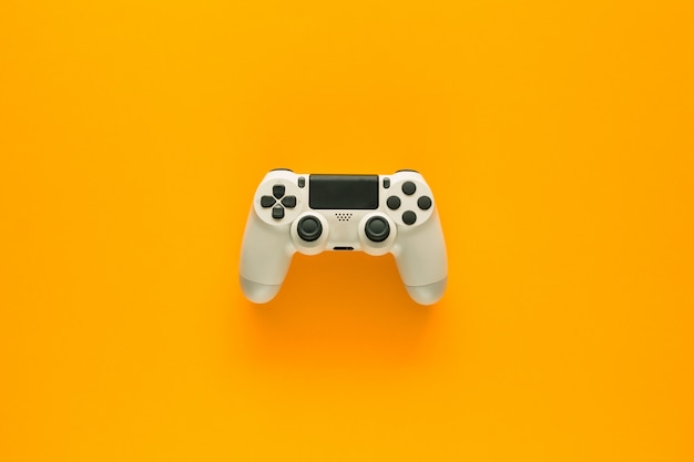 A gamepad on a yellow table