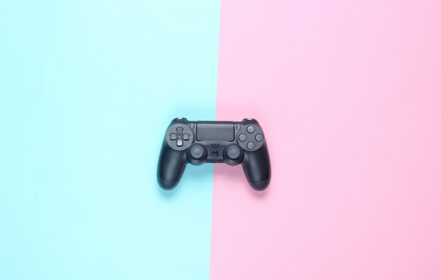 Gamepads on a colored paper. top view. minimalism