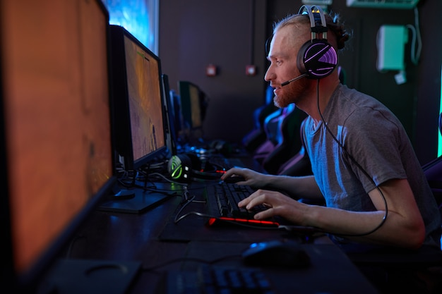 Gamer playing in computer video game