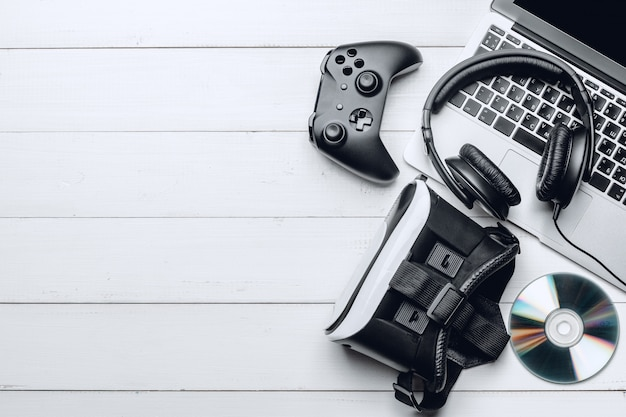 Gamer workspace concept with wooden background, top view