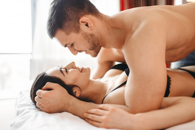 Games of intimate partners in bedroom, hot lovers