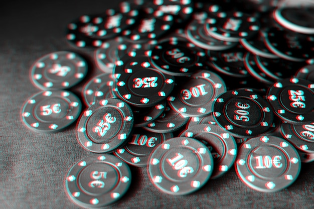 Gaming chips for gambling card games and poker on the table close-up. black and white photo with glitch effect