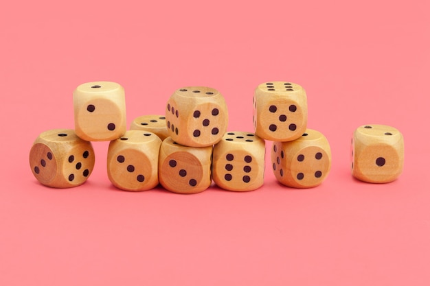 Gaming dice on pink background. concept for games.