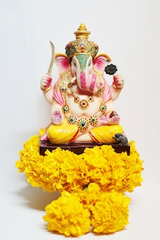 Ganesha god is the lord of success god of hinduism on marigold flowers