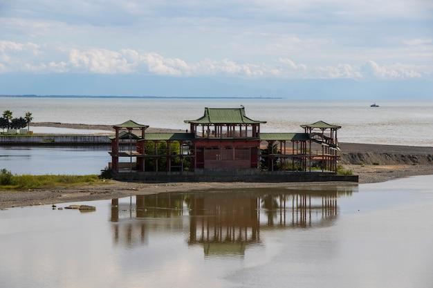 Ganmukhuri, georgia -september 28, 2021: chinese house on the beach of ganmukhuri, georgia and sea landscape