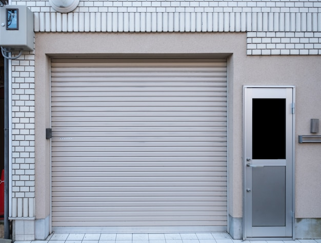 Garage with door residence on white brick