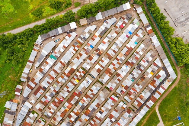 Garages on the edge of the city taken from above by a drone