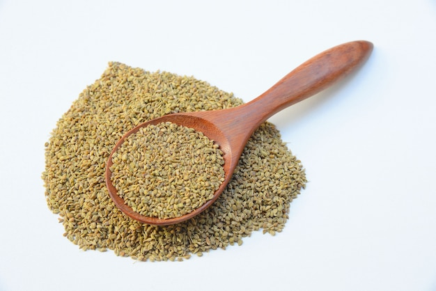 Garam masala powder in wooden spoon on white background