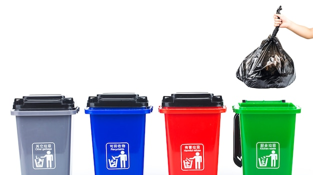 Garbage classification conceptŒcolorful plastic garbage cans isolated on white