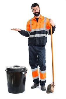 Garbage man holding something