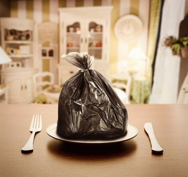 Garbage package on the plate in luxury appartment