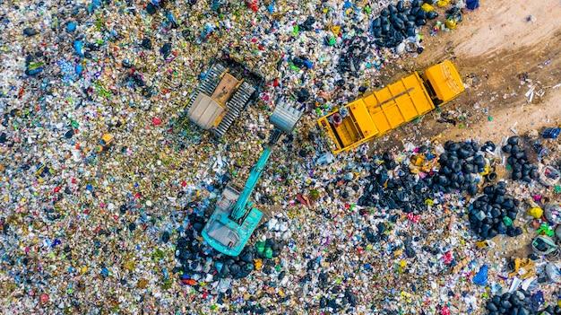 Garbage pile  in trash dump or landfill, aerial view garbage trucks unload garbage to a landfill,  global warming.