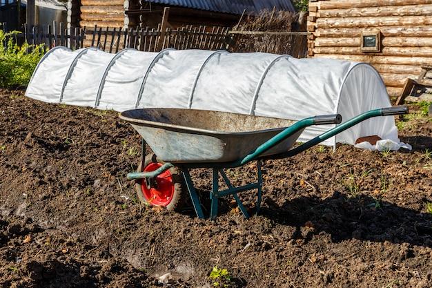 Garden cart for carrying cargo in the garden