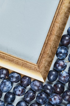 Garden plums around the picture frame. high quality photo