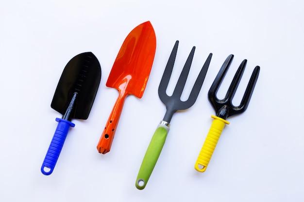 Garden shovel and fork isolated on white background