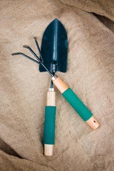 The garden tool a shovel, a rake, sackcloth Premium Photo
