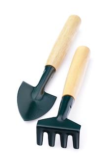 Garden tools isolated on white background shovel and rake
