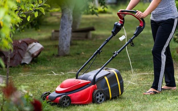 Gardener mowing the lawn at backyard. landscape, terrain at backyard