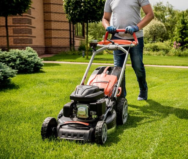 Gardener mowing the lawn.