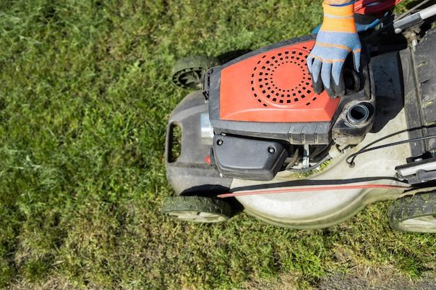 Gardener opened the mower's fuel filler neck