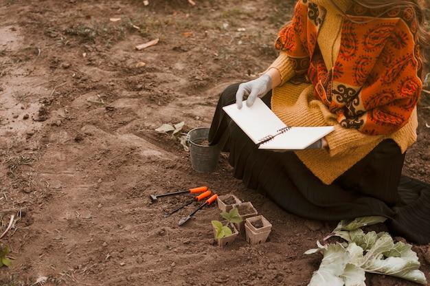 Gardener reading