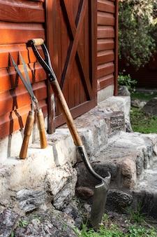 Gardener tools beside house