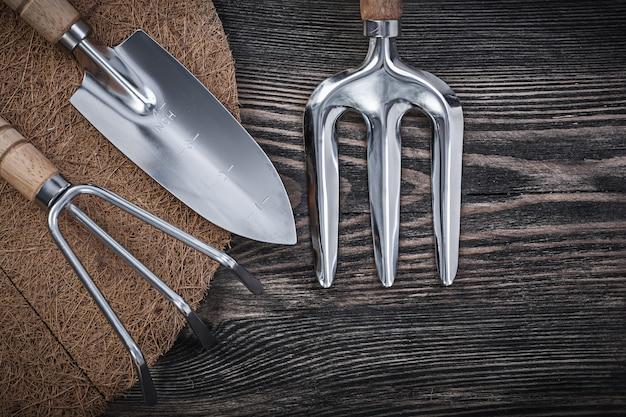Gardener tools on wooden surface