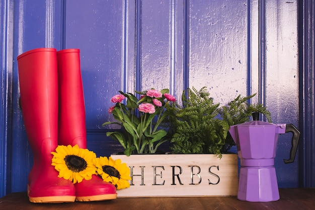 Gardening composition with gumboots and coffeepot