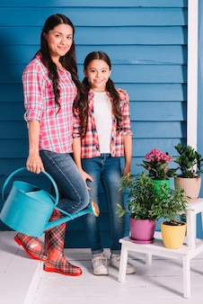 Gardening concept with mother and daughter