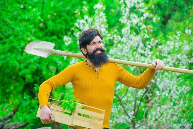 Gardening plants farm work in garden spring gardener with gardening shovel work in garden gardener