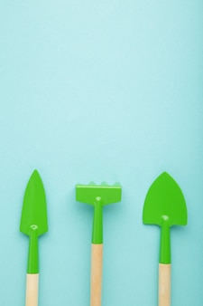 Gardening tools on blue surface with copy space